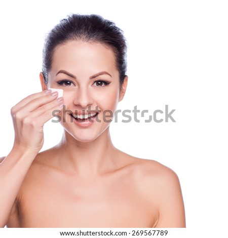 Beautiful Young Woman Touching Her Face.Fresh Healthy Skin.Isolated on White - stock photo