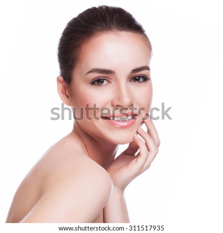 Beautiful Young Woman Touching Her Face.Fresh Healthy Skin.Isolated on White