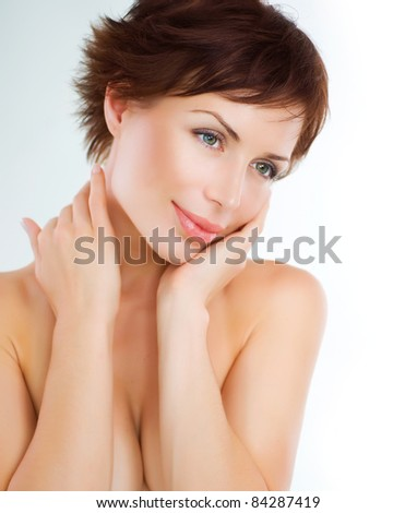 Beautiful Young Woman touching her Face. Skincare .Perfect Skin - stock photo
