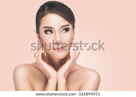 Beautiful Young Woman touching her Face, Skincare, Perfect Skin, Spa on pink background with clipping path. - stock photo