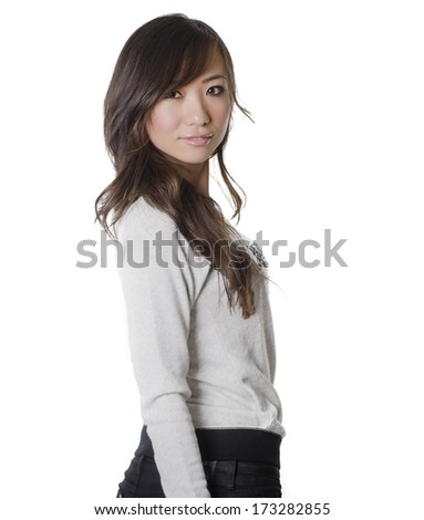 Beautiful young woman turning head around isolated against white background - stock photo
