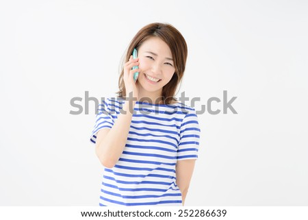 Beautiful young woman using a mobile phone. Portrait of asian. - stock photo