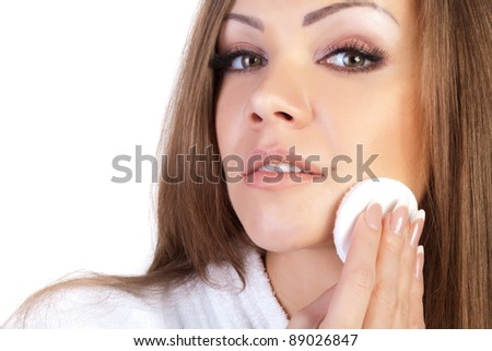 Beautiful young woman using cotton pad on the face close-up - stock photo