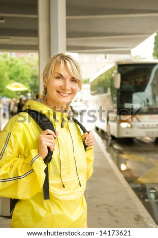 Beautiful young woman waiting for the bus - stock photo