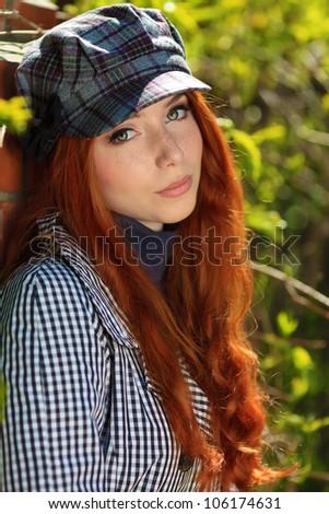 Beautiful young woman walking down the street. - stock photo