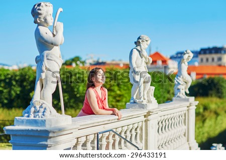 Beautiful young woman walking in Belvedere in Vienna, Austria - stock photo