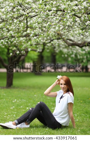 beautiful young woman walking in park