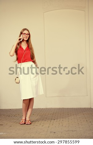 Beautiful young woman walking in the city and talking on cell phone. Beauty, fashion. Businesswoman outdoor. - stock photo