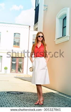 Beautiful young woman walking in the city. Beauty, fashion. Businesswoman outdoor. - stock photo