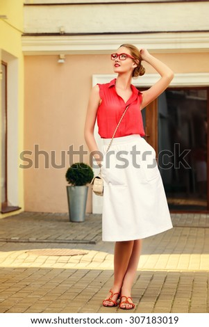 Beautiful young woman walking in the city. Beauty, fashion. Businesswoman outdoor.