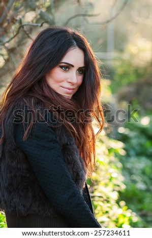 Beautiful young woman walking in the park, selective focus