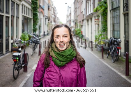 Beautiful young woman walking on the streets of Amsterdam