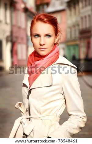 beautiful young woman walking outdoors - stock photo