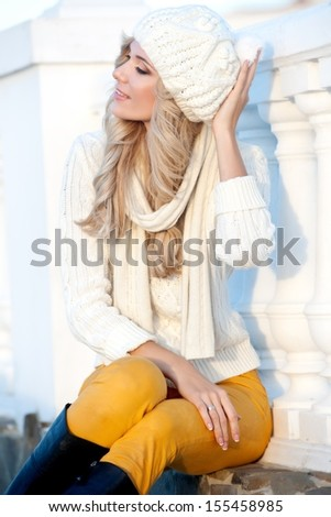 beautiful young woman walking outdoors in autumn  - stock photo