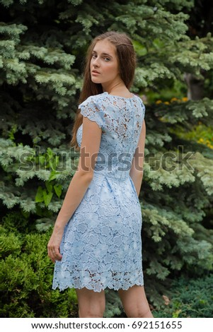 Beautiful young woman wearing a light summer dress