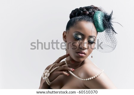 """Beautiful young woman wearing a retro style hat with net veil (""""bibi hat""""), isolated on grey - stock photo"""