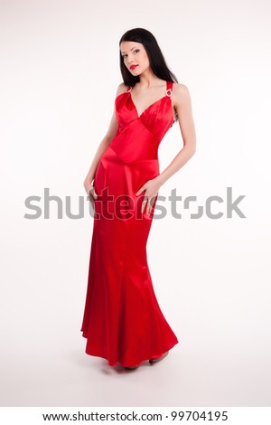 Beautiful young woman wearing a sexy evening dress - stock photo