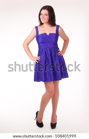 Beautiful young woman wearing a sexy violet evening dress