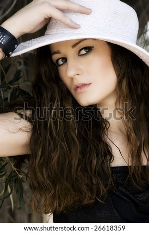 Beautiful young woman wearing a white hat
