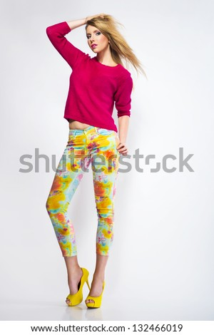 beautiful young woman wearing casual clothes yellow high heels shoes posing and looking at camera isolated on white background - stock photo
