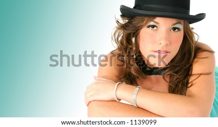 Beautiful young woman wearing formal dress, top hat, bow tie and diamonds. - stock photo