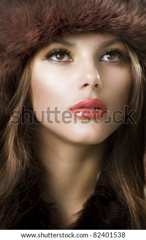 Beautiful Young Woman wearing Fur Hat.Winter Style - stock photo