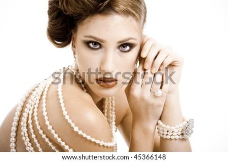 Beautiful young woman wearing jewels in a fashion portrait - stock photo