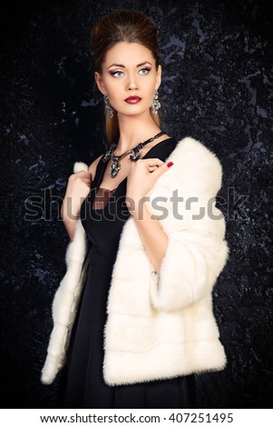 Beautiful young woman wearing mink fur jacket. Jewellery. Beauty, fashion. Studio shot.  - stock photo