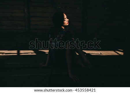 beautiful young woman wearing national ukrainian clothes  in wooden hut
