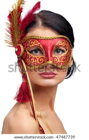 beautiful young woman wearing red carnival mask - stock photo