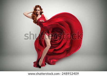 Beautiful young woman wearing red rose dress. - stock photo
