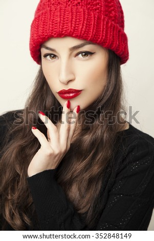 beautiful young woman wearing red winter wool cap