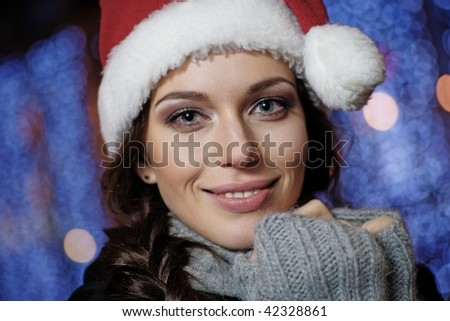 beautiful young woman wearing santa hat - stock photo