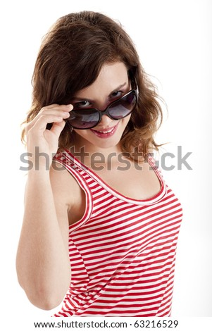 Beautiful young woman wearing sunglasses, isolated on white