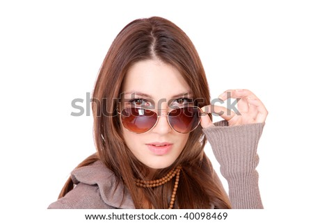 Beautiful young Woman wearing sunglasses isolated on white background