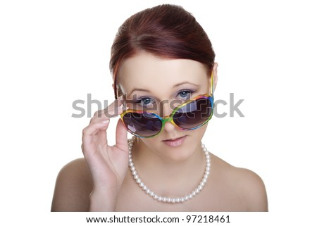 Beautiful young woman wearing sunglasses isolated on white background. Glamour portrait.