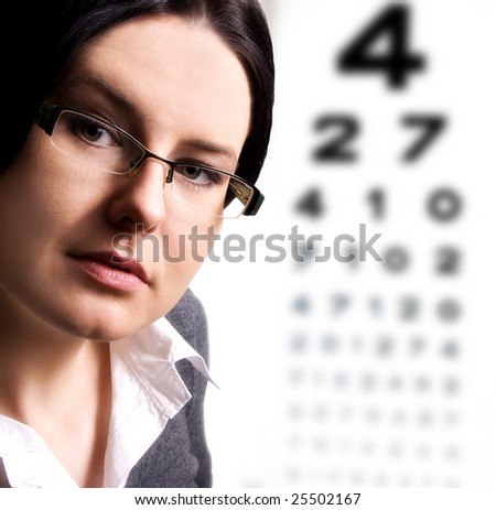 Beautiful young woman wears trendy glasses - stock photo