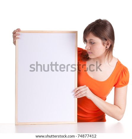beautiful young woman with a blank sign, billboard - stock photo