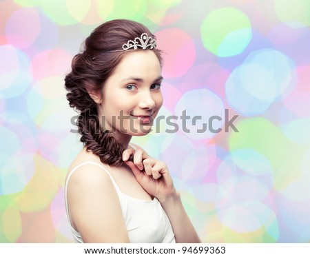 Beautiful young woman with a braid wearing a diamond diadem - stock photo
