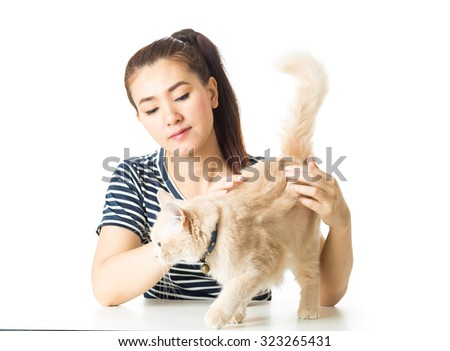 Beautiful young  woman with a cat on white background