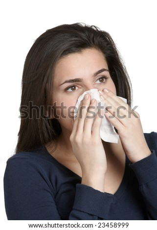 Beautiful young woman with a cold blowing nose - stock photo