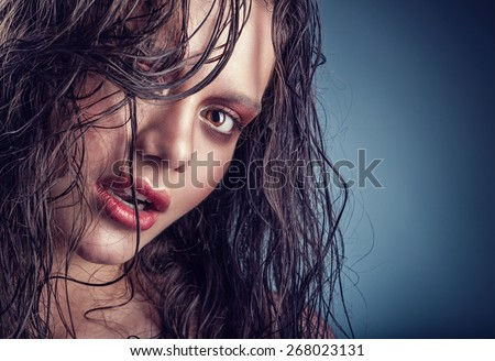 Beautiful young woman with a gentle makeup and wet hair - stock photo