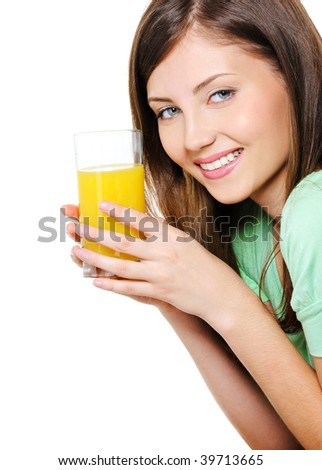 Beautiful young woman with a glass of fresh orange juice over white background - stock photo