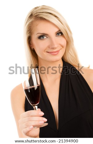 Beautiful young woman with a glass of red wine - stock photo
