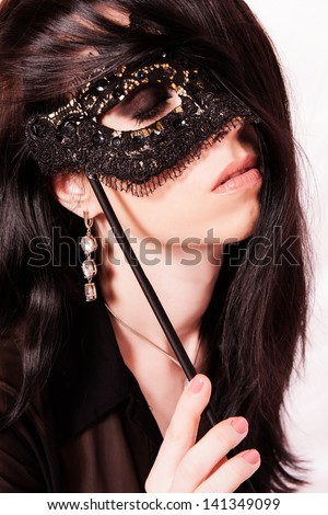 Beautiful young woman with a mask. - stock photo
