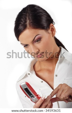 beautiful young woman with a mobile phone typing sms
