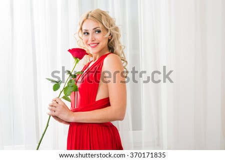 Beautiful young woman with a rose
