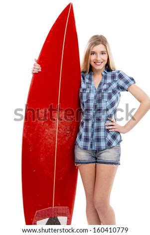 Beautiful young woman with a surfboard, over a gray background