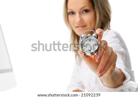 beautiful young woman with alarm clock - stock photo