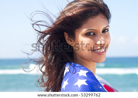 beautiful young woman with american flag - stock photo